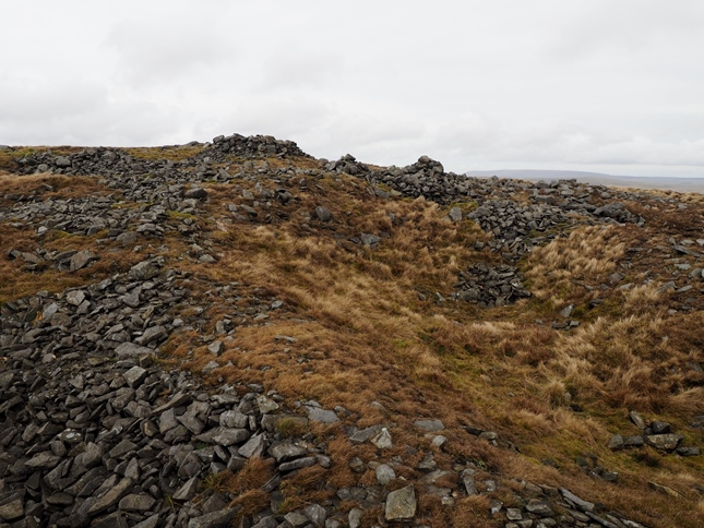 The quarried looking area to the south of the summit