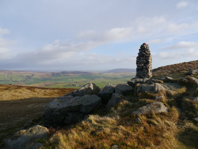 The cairn on the western end of the summit ridge
