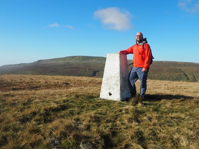 By the trig point on Blea Moor with Whernside in the background