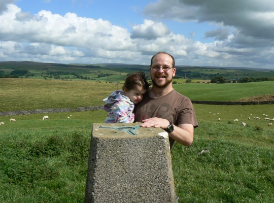 By the Haw Crag trig point with my daughter in 2009