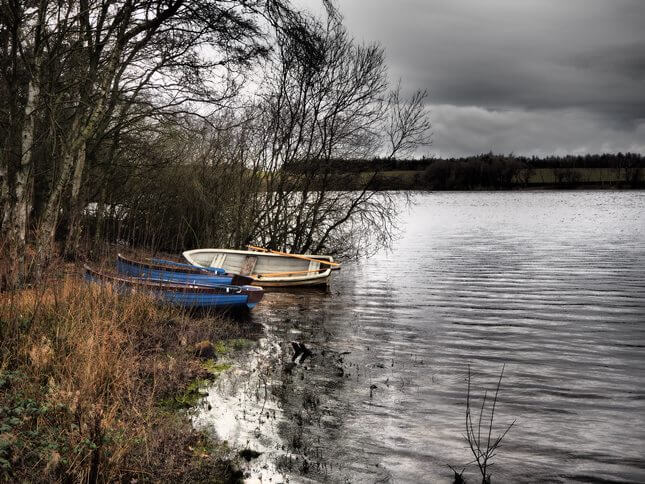 A couple of boats on the shore of Lumley Moor Reservoir