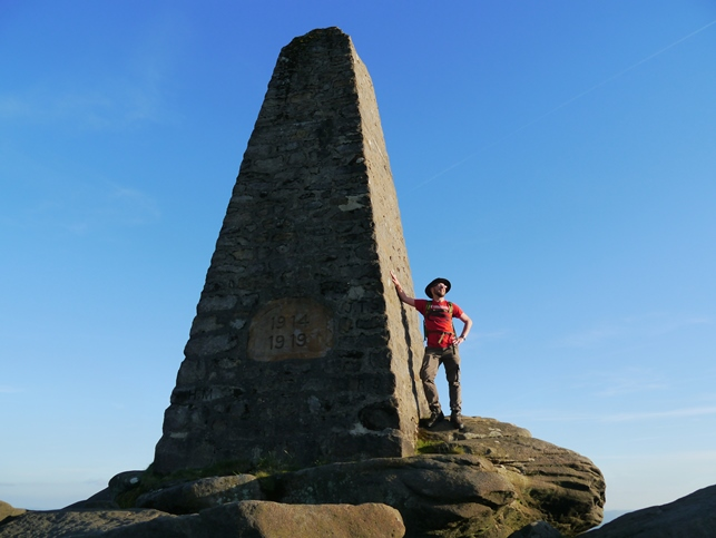 Posing next to the obelisk on the summit of Cracoe Fell