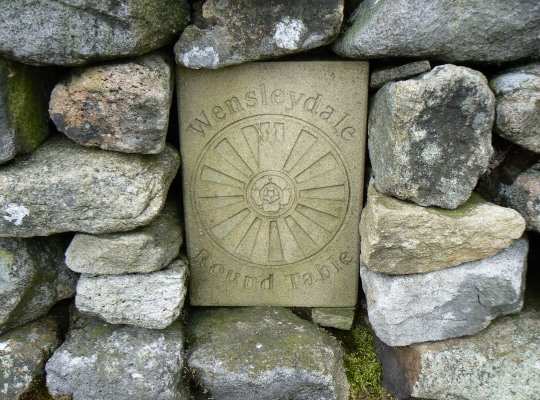 The Wensleydale Round Table plaque on the shelter