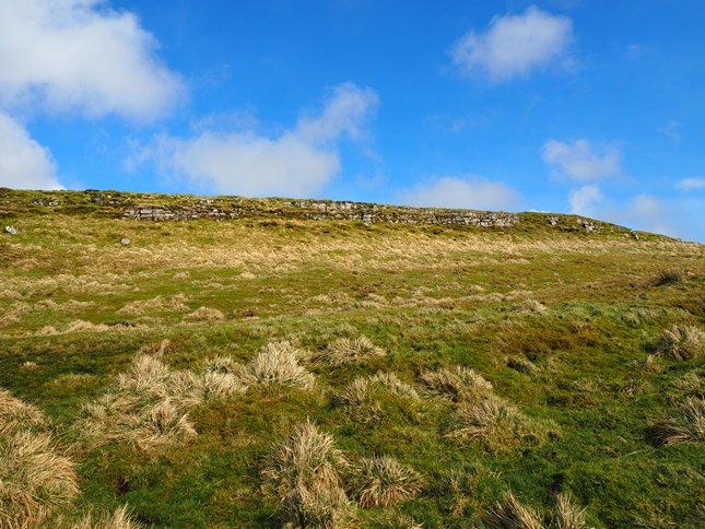 The small limestone edge immediately to the west of the summit