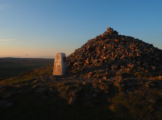 The Beamsley Beacon trig point is dwarfed by the huge cairn next to it