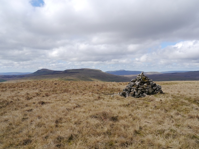 The large cairn on the western side of the wall