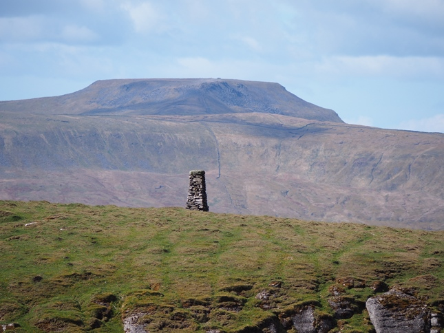 The cairn on Cosh Knott with Ingleborough looming in the background