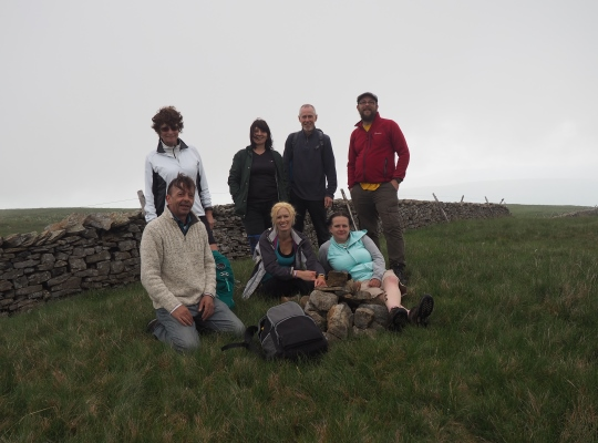 With a group of friends by the small pile of stones marking the summit