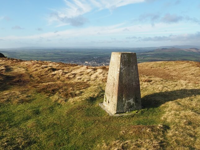 The Vicar's Alltoment trig point on the top of Skipton Moor