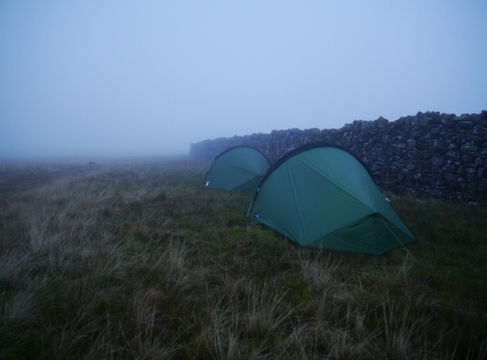 Wild camping in the shelter of the wall runnig across the top of Swarth Fell