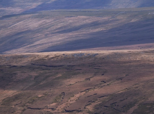 Zooming in on the Blea Moor trig point from Whernside