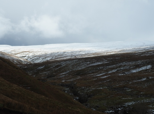 A snow covered Green Hill above the upper reaches of Ease Gill