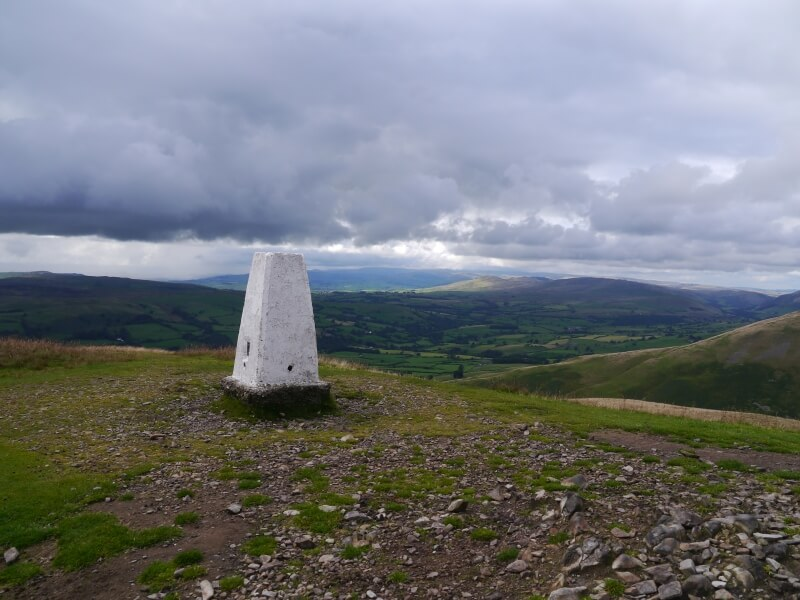 The trig point on Winder looking towards the Lake District