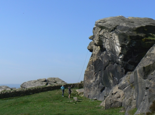 Climbers preparing their route on Almscliff Crag