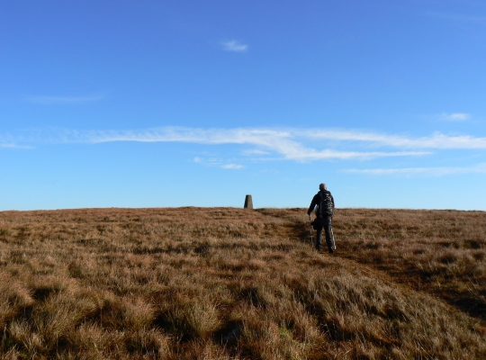 My friend Matthew approaching the Gragareth Fell trig point in November 2010