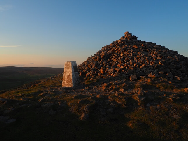 The trig point is located next to a massive cairn of ancient origins
