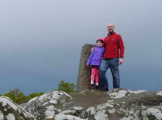 With my daughter by the Brimham Rocks trig point in May 2014