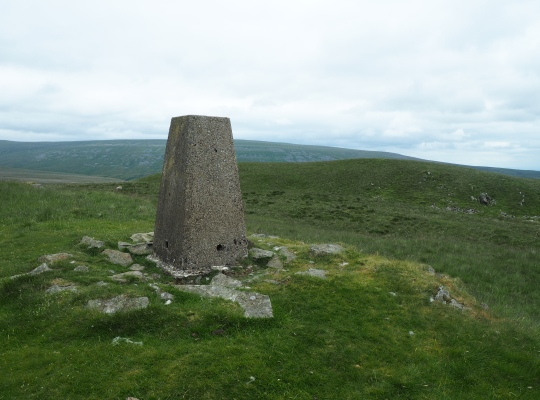 The trig point looking south-east to the slightly higher knoll that is the summit