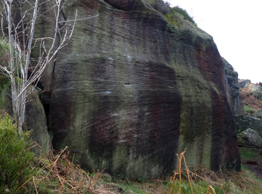 The tell tale chalk marks on one of the boulders of Caley Crags