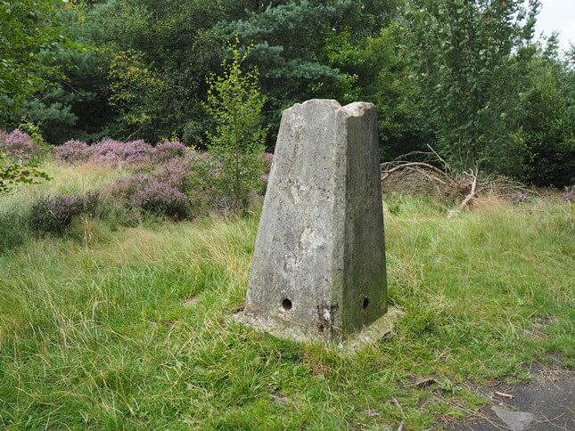The top of the trig point has clearly been damaged when someone stole the spider