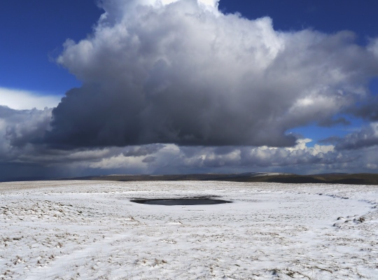 A shrunken Calf Tarn in the snow