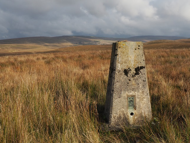 The Cave Hill trig point looking towards Cam Fell.