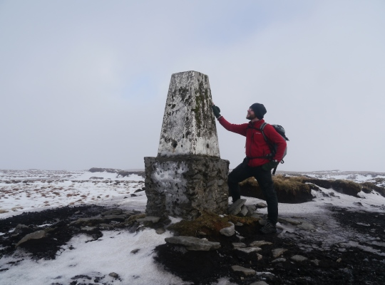 The Cow Close Fell trig point in winter