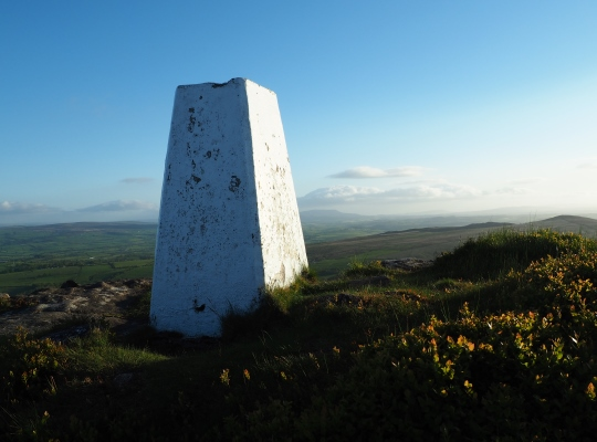 The Crookrise Crag Top trig point looking towards Pendle Hill