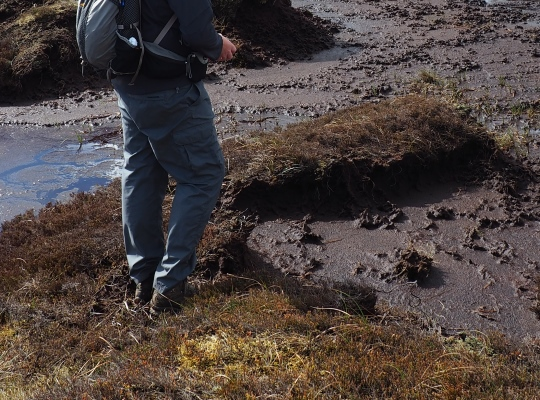 Negotiating a peaty area of Fleets Moss to reach the tarn