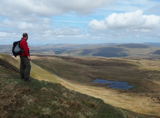 Looking down on Greensett Tarn from high on Whernside above