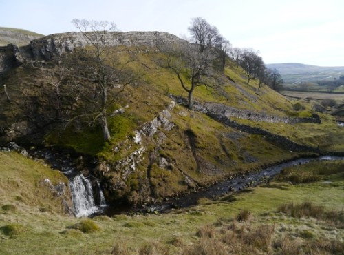 Disher Force is situated below the limestone scar of Haw Bank