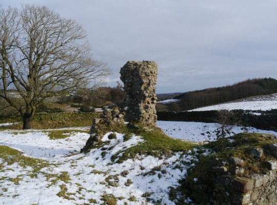 The ruins of John O'Gaunts Castle stand above the reservoir