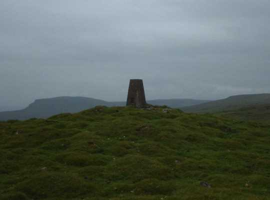 The Knowe Fell trig point looking towards Pen-y-ghent and Fountains Fell