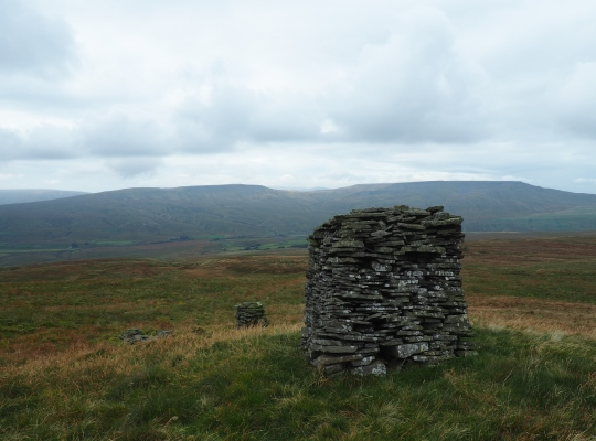 Two of the stone pillars to the west of the summits