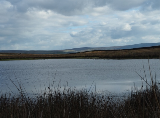 Looking across Mossy Moor Reservoir towards Great Pockstones and Simon's Seat