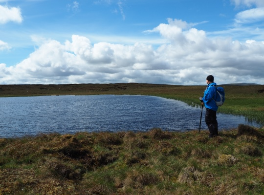 My friend Paul contemplating the lonely setting of Oughtershaw Tarn