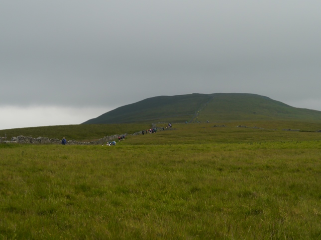 Walkers following the ridge wall on to Birks Fell