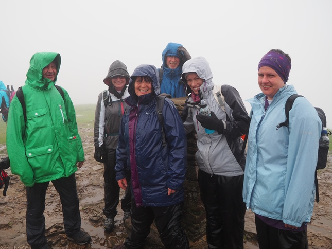 Six of my friends on a typically wet and cloudy summit of Pen-y-ghent when we did the Yorkshire Three Peaks in 2016