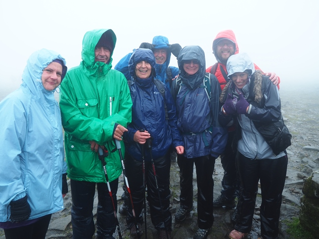 The team looking very wet on Ingleborough, the final summit of the Yorkshire Three Peaks Challenge Walk