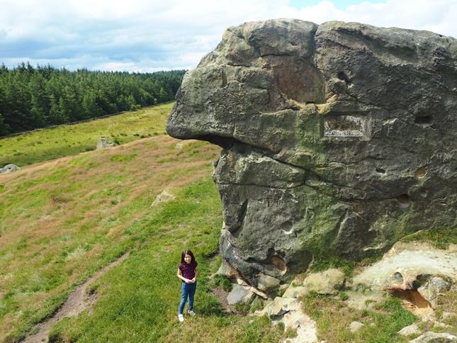 My daughter below the highest of the rocks at Little Alms Cliff
