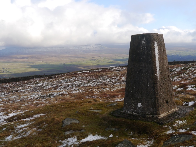 The Park Fell trig point looking towards Pen-y-ghent