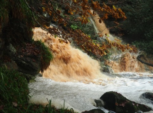 The upper falls in spate creating instant bubble bath