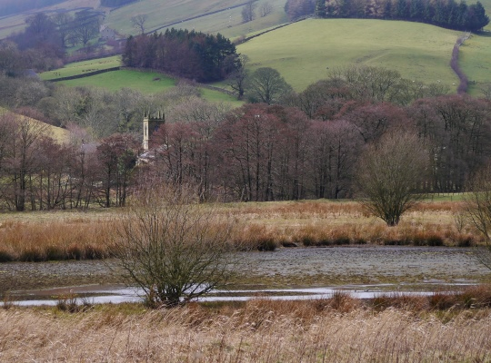 Looking across the northern end of the reservoir towards Ramsgill's church