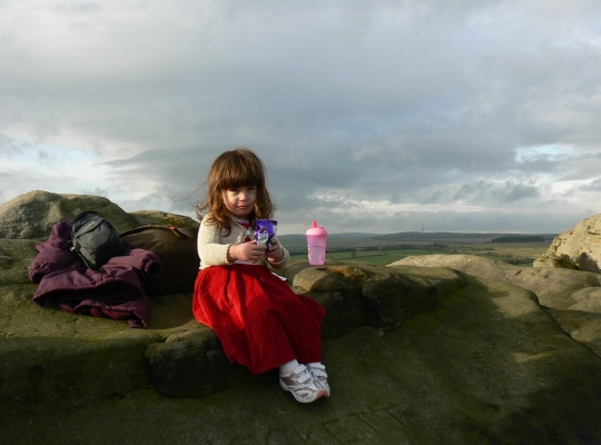 My daughter Rhiannon, then aged two, having a picnic on Almscliff Crag