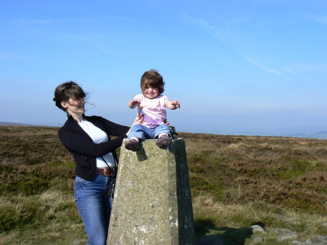 My wife and daughter by the Rombalds Moor trig point in 2008