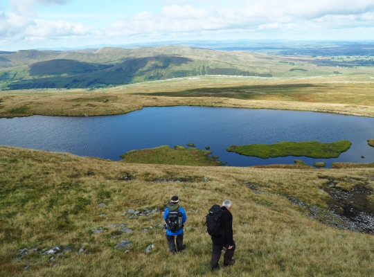 My friends Wally and Gary dropping down to Sand Tarn from the top of Wild Boar Fell