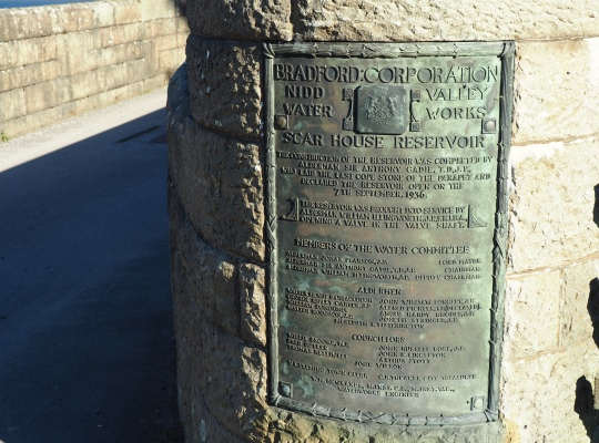 A commemorative plaque on Scar House Reservoir's dam marking the opening of the reservoir