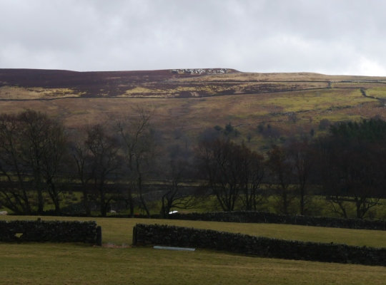 Looking up at Sigsworth Crags from the track climbing up on to the moors from Bouthwaite