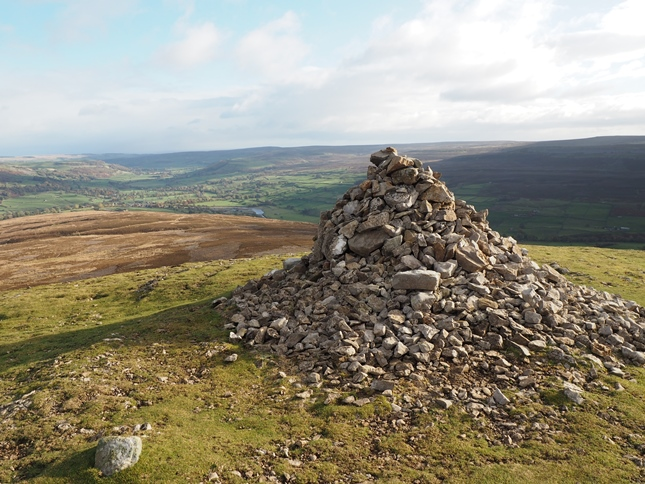 The large cairn on the top of Calver Hill