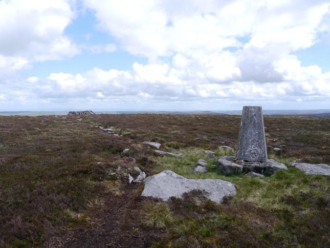 The Water Crag trig point looking towards the stone shelter